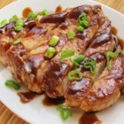 San Francisco Pork Chops - Tender pork chops simmer in a sweet and savory sauce flavored with beef broth, garlic, and soy sauce with just a pinch of red pepper flakes for zing.
