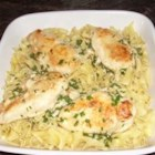 Garlic Chive Chicken - These flavorful chicken breasts are bathed in a lemony garlic butter.  Easy to make, they are great for a light dinner.