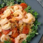 Garithes Yiouvetsi - This classic Greek shrimp dish is baked with a tomato sauce and topped with feta cheese.  Relatively quick and simple to make. This recipe goes wonderfully with rice pilaf and some crusty bread.