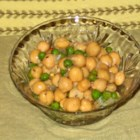 Simple Garbanzos - Garbanzo beans and peas are coated with a seasoned olive oil dressing and served chilled.
