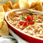 Hot Roasted Red Pepper and Artichoke Dip  - This almost one-dish appetizer is cooked and kept warm in a slow cooker so your guests can enjoy it for hours to come!