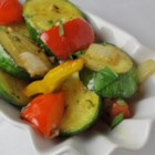 Garlic Vegetable Saute - A delicious mix of fresh zucchini and yellow and red bell peppers are cooked in butter and olive oil. Jalapeno pepper and garlic add a fragrant zing.
