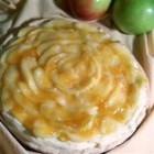 Old Fashioned Apple Cream Pie - Tart, sweetened apples, with a bit of lemon juice and butter stirred in, are cooked on the stove until tender. Then they 're spooned over a wonderful cream cheese and vanilla pudding filling, and brushed with an apricot glaze.