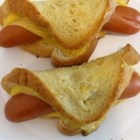 Wiener Winks - Beef frankfurters wrapped in cheese and bread, buttered and baked to a golden brown.