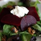 Beet Salad with Goat Cheese - This is a delicious and easy salad which takes little time and is a great meatless main course. It uses beets, goat cheese, candied walnuts and baby greens.