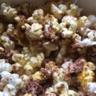 Candy Bar Popcorn - Popcorn and Snickers(TM) - a much-too-easy yummy treat! Of course you can substitute the Snickers(TM) with any variety of meltable candy bars. It's the sweet and salty combination that you want!