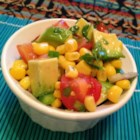 Corn Salad with Lime Vinaigrette - This summer picnic-salad recipe mixes corn, tomato, and avocado in a simple lime dressing for a delicious side dish or dip for chips.