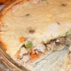 Becca's Custom Turkey Shepherd's Pie - Hearty and chock-full of veggies, this recipe calls for ground turkey that is sauteed with onion, parsley, thyme, garlic and veggies, all layered in a whole wheat crust with cheese and mashed red potatoes. It makes two 9-inch pies.