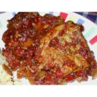 Tomato Pork Loin Chops - Pork chops are browned, then braised in an enticingly seasoned tomato sauce. This simple recipe for pork will make quite an impression at the dinner table.