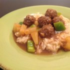 Sweet and Sour Meatballs IV - Beef meatballs simmered in a sauce of brown sugar, lemon and pineapple juice, with chopped green pepper and pineapple chunks. Great served over rice.