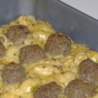 Southwestern Macaroni and Cheese with Adobo Meatballs - A smooth and surprising macaroni and cheese recipe with savory Mexican meatballs that will make you say 'Ole! Gimme more!'