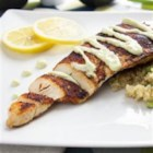 Blackened Chicken with Avocado Cream Sauce - Homemade blackened seasoning brings the heat to your pan-fried chicken breasts to be served over quinoa and under a creamy avocado sauce in this easy recipe.