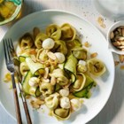 Spinach Cheese Tortellini with Zucchini, Mozzarella and Toasted Almonds - Zucchini ribbons are an easy and nutritious way to add whimsy to your pasta dish! Combine them with classic spinach and three cheese tortellini, along with mozzarella and almonds, and you've got a fun, authentic Italian dish.