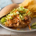 Slow Cooker BBQ Pulled Pork Sandwiches - Your favorite summer sandwich just got a whole lot easier--Reynolds(R) Slow Cooker Liners make for a juicy pulled pork and virtually no cleanup!