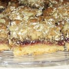Grandma's Raspberry Bars - A crust of butter, sugar and flour is layered with raspberry jam, then topped with oats  and walnuts.