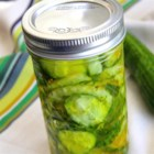 Thirty Minute Bread and Butter Pickles - Who knew the microwave was a pickle's best friend? Cucumbers, onions and spices become crisp and delicious pickles in minutes!