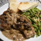 Stuffed Pork Chops I - Skillet browned pork chops with bread cubes, butter, chicken broth, celery, onion and mushroom soup, then baked to perfection.  These chops will please most anyone.