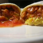 Breakfast Burritos - A different way to start your day.  Burritos with fried eggs, bacon and refried beans topped with melted cheese.  Ham or sausage may be substituted for the bacon.  Serve with salsa on the side.