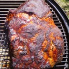 Bob's Pulled Pork on a Smoker - Pork shoulder is brined in a flavorful blend of apple cider and a classic blend of barbeque spices, then smoked until fork tender for a crowd-pleasing dinner.