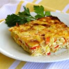 Corn-Onion Pudding - This corn, onion, and bell pepper pudding is savory and delicious year-round.  It's also packed with antioxidants!