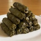 My Own Famous Stuffed Grape Leaves - These are grape leaves, stuffed with a tantalizing mixture of rice, fresh dill, mint and lemon. 'Yum' is the only one word to describe these. These can either be a main dish or an appetizer, depending on your appetite. Serve with good crusty bread and a Greek salad, if desired.