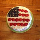 All-American Flag Cake - A pretty decorated cake with a layer of fluffy blueberry filling gets a topping of red and white strips and fresh blueberry stars. It's great for Memorial Day or any patriotic occasion.