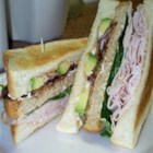 Awesome Turkey Sandwich - A fantastic sandwich with sliced turkey, guacamole, toasted whole wheat bread, fresh tomato, lettuce, bean sprouts, yellow mustard and light mayo. For cheese lovers, Colby-Jack makes a great addition as well. No one I know can resist this one!