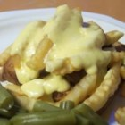Horseshoe - Originating in Springfield, Illinois the Horseshoe is a regional favorite. This open-faced sandwich is made with toasted bread topped with hamburger patties and piled high with french fries and cheese sauce. This is a special treat is sure to impress your friends on game day!