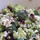 Best Baconless Broccoli Salad - Pumpkin and flax seeds, red onion, dried cranberries, and pecans are tossed with broccoli in a raspberry vinegar-flavored dressing in this recipe.