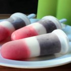 Red, White, and Booze Ice Pops - Celebrate your independence this July 4th by making these red, white, and booze ice pops! Strawberry, cheesecake, and blueberry layers are spiked with vodka for this patriotic treat!