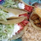 Chicken Tacos - This recipe is quick and easy - good for those nights you don't have a lot of time to prepare dinner. Chicken breast is simmered in a lemon-lime marinade, then served with taco fixin's so that everyone can make their own soft taco.