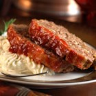 Blue Ribbon Meatloaf from Crosse & Blackwell - Zesty cocktail sauce in the ground beef blend and the mustard-brown sugar glaze lend rich flavor to this classic family favorite.
