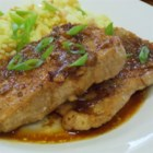 Pork with Plum Sauce - A sweet and savory plum sauce, flavored with ginger and cloves, highlights the flavor of pan-braised pork chops for an easy summertime dinner.