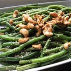 Japanese-Style Sesame Green Beans - Fresh green beans are cooked whole in canola and sesame oils, then splashed with soy sauce and served with toasted sesame seeds.