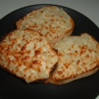 Cheese Onion Garlic Bread - Plenty of garlic and melted Italian cheeses taste wonderful on pieces of sliced French bread.