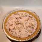 Cannoli Pie - A light pie with lots of cannoli flavor. A big success at holiday parties. More or less cherries, almonds or chips maybe used according to taste.