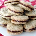 Magic Walnut Cookies - Crisp walnut cookies sandwiched around rich chocolate filling.