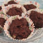 Chocolate Krisps - Melted chocolate, crispy rice cereal, and nuts are combined in little paper candy cups creating a delightful chocolate treat perfect for Mother's day or parties.