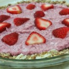 Raw Vegan Strawberry Pie - This delicious twist on strawberry pie uses almonds, dates, and coconut for the crust. Pureed strawberries and coconut make the filling. It will make your vegan friends happy!