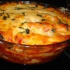 Best Ziti Ever - Ziti is layered with sausage, ricotta, mozzarella and tomato sauce, then baked until bubbling.