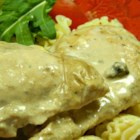 Simple Chicken Stroganoff - Tender chicken breasts are baked with a simple blend of cream of mushroom soup, sour cream, and Worcestershire sauce to make a comforting sauce for egg noodles.