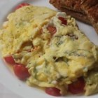 Chef John's Summer Scrambled Eggs - Chef John's recipe for summery scrambled eggs features cherry tomatoes, feta cheese, and plenty of fresh basil.