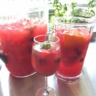 Watermelon Sangria - Fresh watermelon sangria is like summertime in a glass.  Just blend watermelon into a juice, and pour over fresh fruit along with white wine, vodka, and orange liquor.