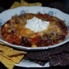 Taco Soup III - Browned ground beef is combined with packets of ranch dressing mix and taco seasoning in this soup with tomatoes, green chilies, kidney beans and canned hominy.  Serve with sour cream and grated cheese.