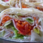 Easy Snack Wraps - So easy to make, these bite sized wraps filled with turkey, cream cheese and veggies are a great way to fill up an appetizer tray - and your hungry guests' bellies.