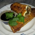 Bekki's Mexican Egg Rolls  - Crispy egg rolls are filled with a spicy South-of-the-Border seasoned ground beef and cheese mixture, then wok fried to crisp the wrappers. A vegetarian version of ground beef can also be used in the filling.