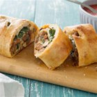 Homemade Spinach Pizza Rolls - Take your pizza upscale and impress your family or guests with these tasty, bite-size pinwheels.