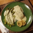Salmon in Creamy Silk Sauce - Salmon cooked in parchment with lemon, rosemary and thyme, served with a silky cream sauce.  Great with steamed asparagus and parsley potatoes.