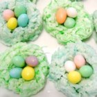 Easter Egg Nests - Make charming presentations for holiday candies with these miniature birds' nests, fashioned from shredded coconut, milk, melted almond bark and a touch of food coloring. The recipe calls for green food coloring, but feel free to experiment!