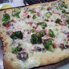 Veggie Ranch Pizza - Delicious and loaded with fresh veggies, this is pizza for people who want a change from tomato sauce. Use any fresh veggies and any pizza crust. Use light dressing and reduced-fat cheese for an even more healthful meal.